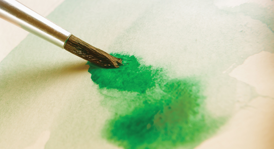 Paint brush painting with green watercolour