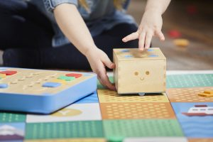 Early childhood hands using Cubetto robot