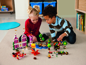 Boy and girl playing with lego bricks