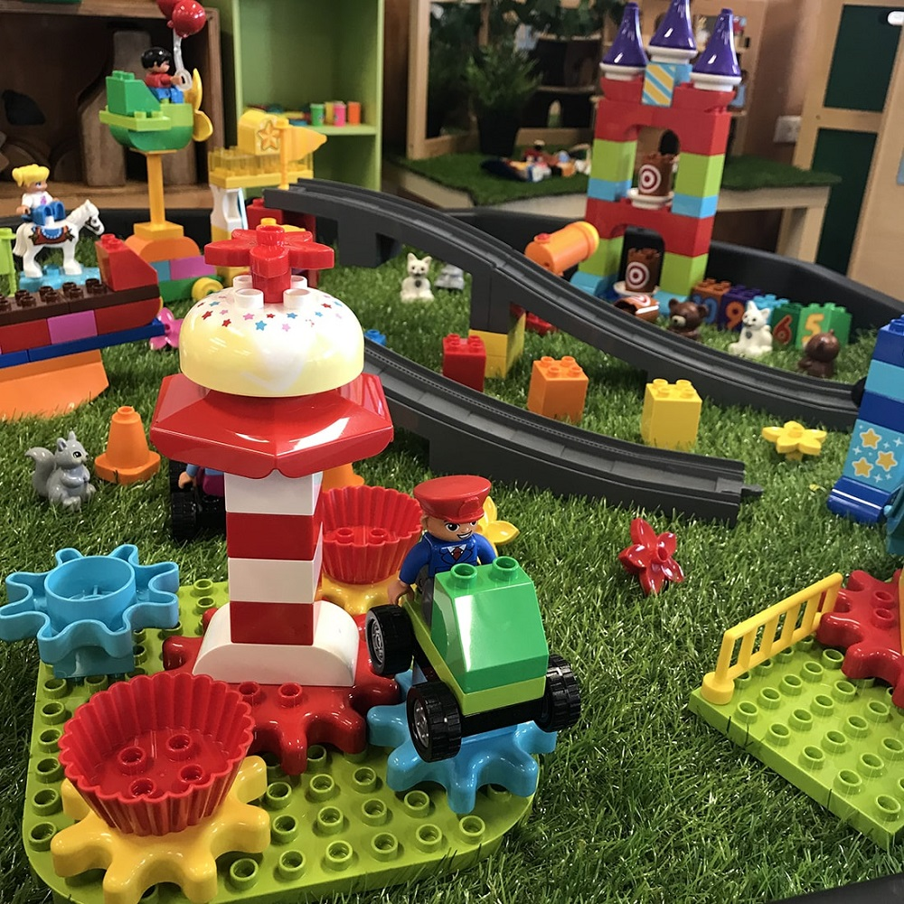 LEGO Steam Park fairground teacup ride with fairy tale castle in background