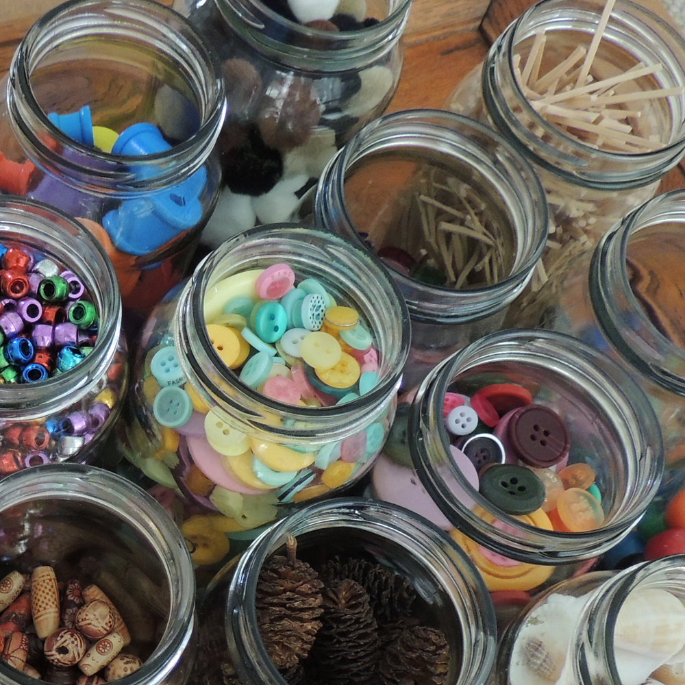 Arial shot of loose parts stored in glass jars