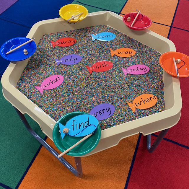 Sight words Hex Tray activity featuring fishing rods and cardboard sight word fish and coloured rice