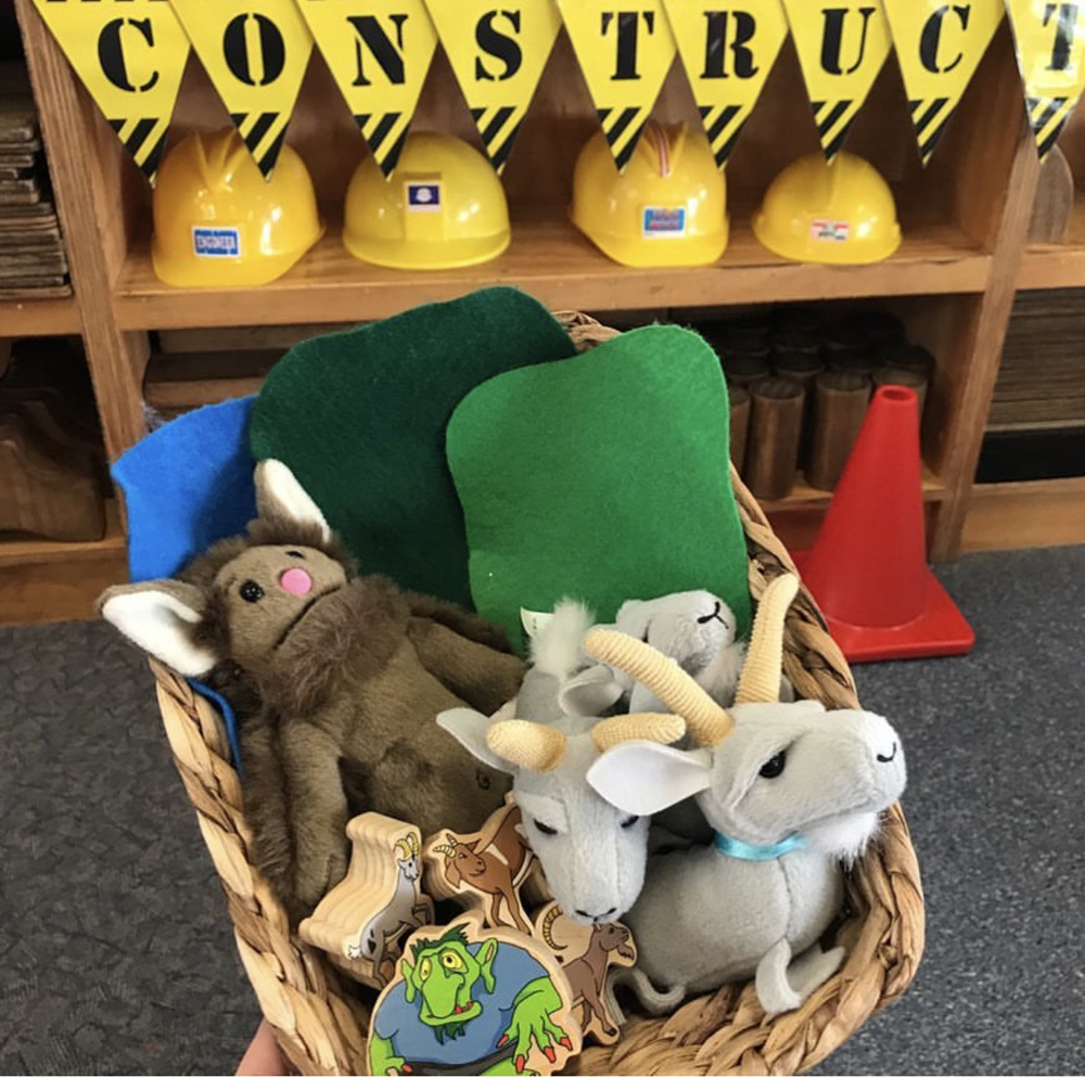 Puppets and soft toys used along with construction blocks to re tell the story three billy goats gruff