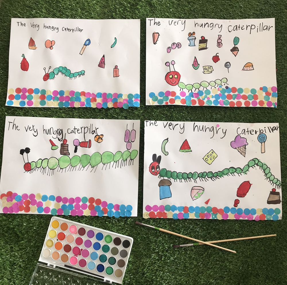 Children used The Very Hungry Caterpillar book written by Eric Carle as inspiration for a painting of their very own hungry caterpillar