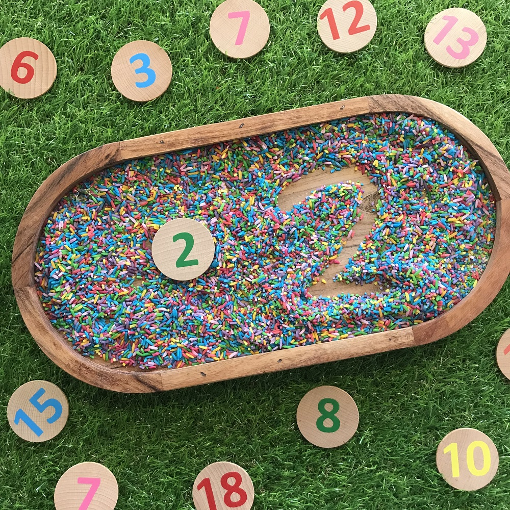 Numeracy Number Formation game in tray with coloured rice