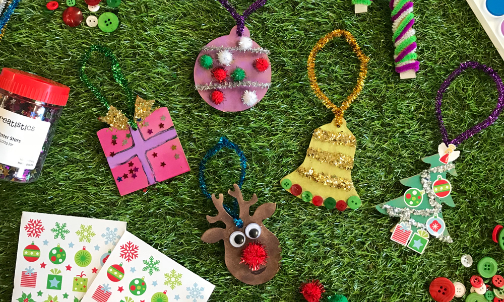 DIY Christmas ornaments sitting on astroturf