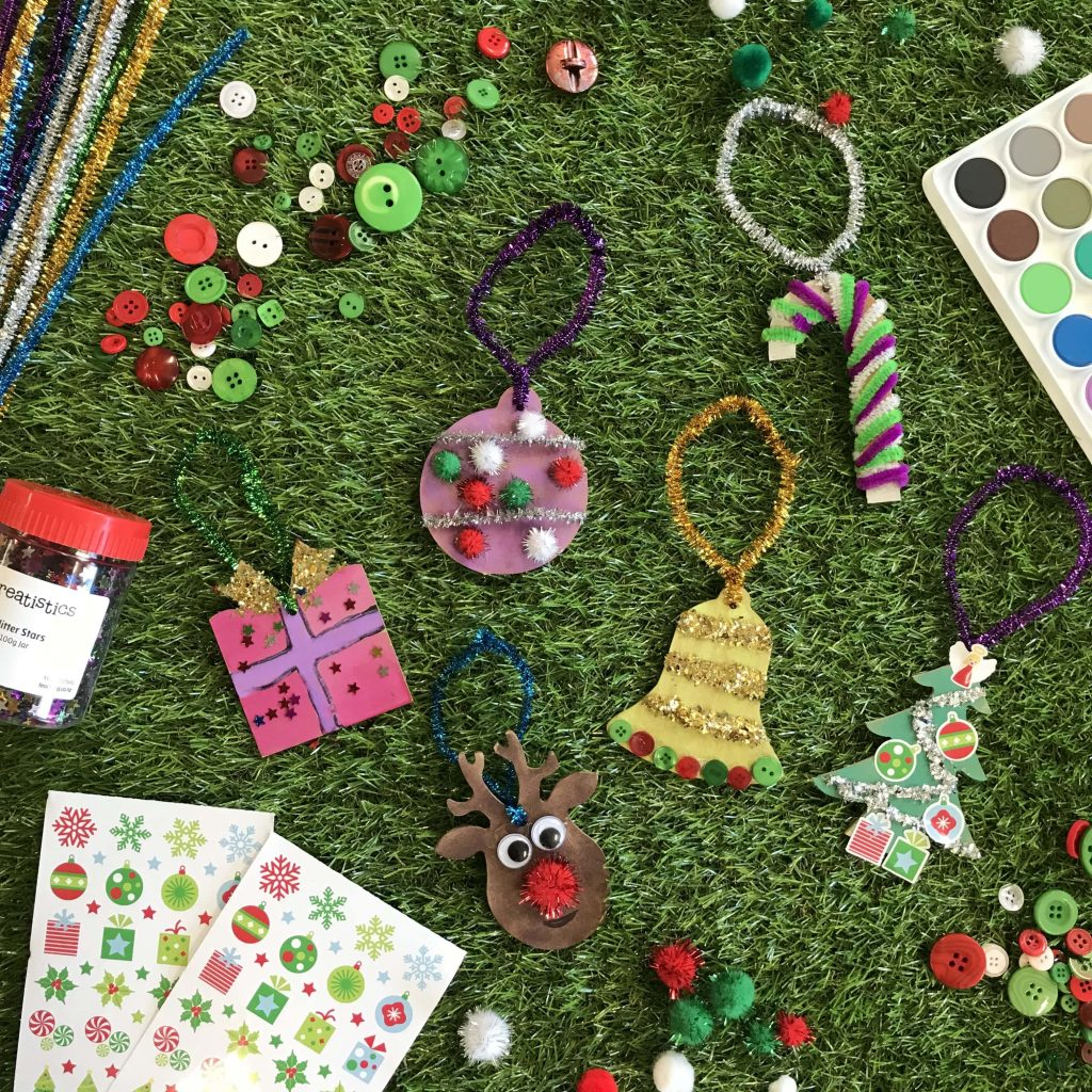 assorted christmas decorations activities and stickers on grass background