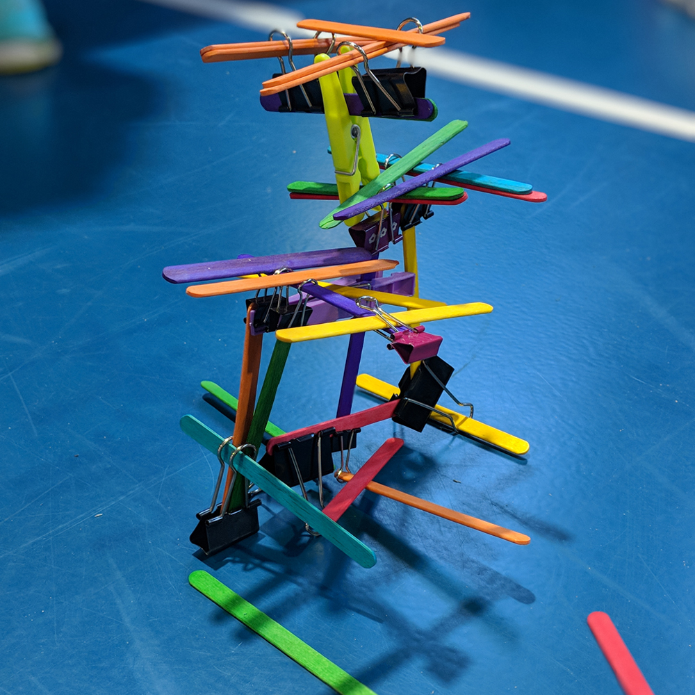 Makerspace towers activity using popsicle stick and foldback clips