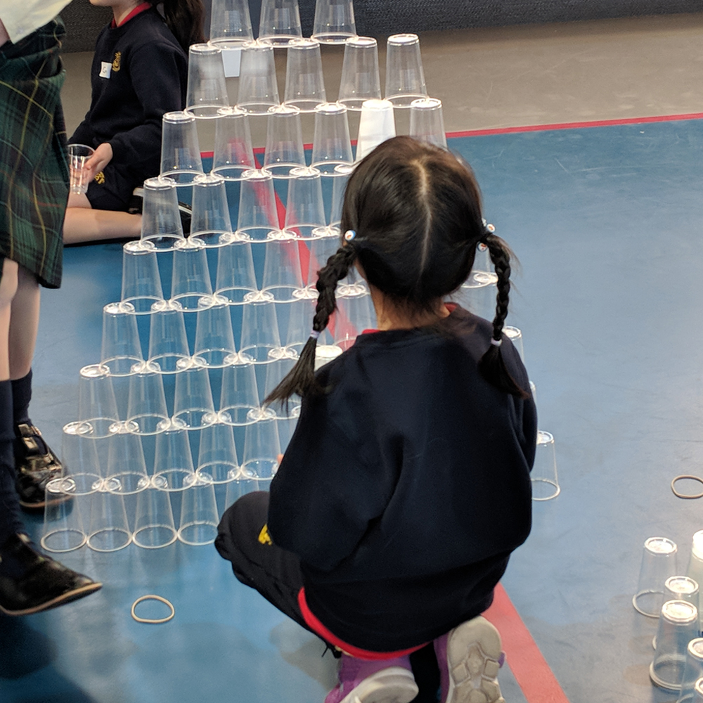 Makerspace cup towers challenge with kid