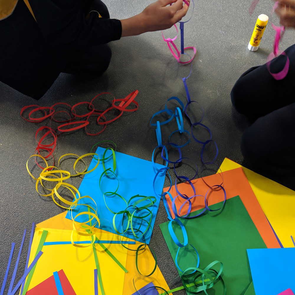 Makerspace longest paper chain challenge finished paperchains on floor
