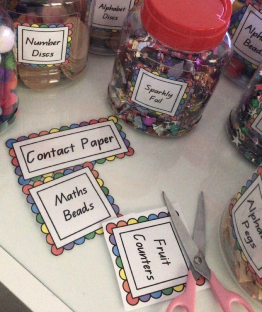 Labelling classroom resources featuring storage jars with descriptive labels