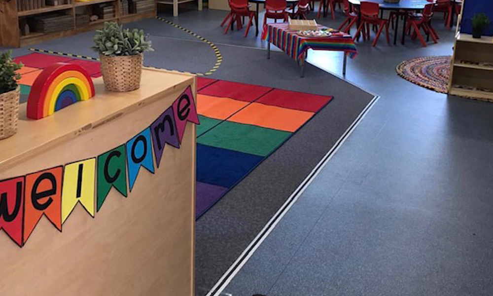 Setting up your classroom featuring welcome sign and colourful carpet