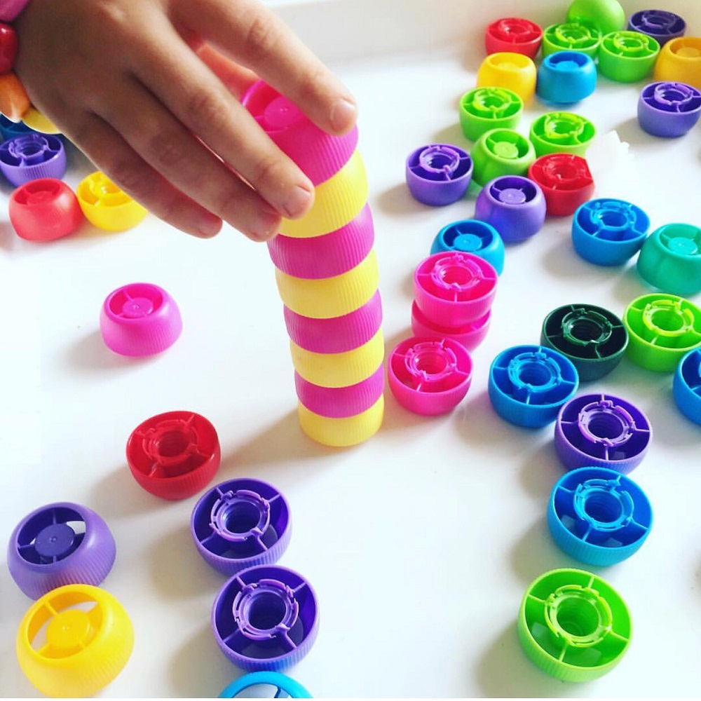 Child stacking colourful counters