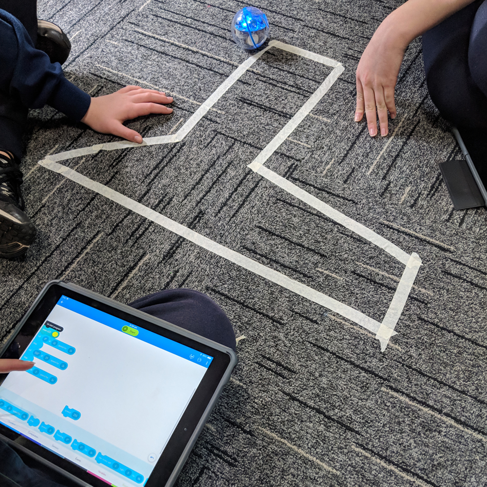 Sphero maths activity with shaped marked on floor