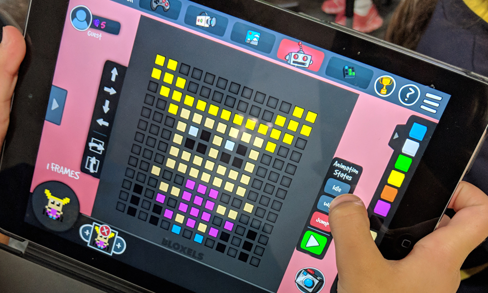 Child playing a Bloxels activity on iPad