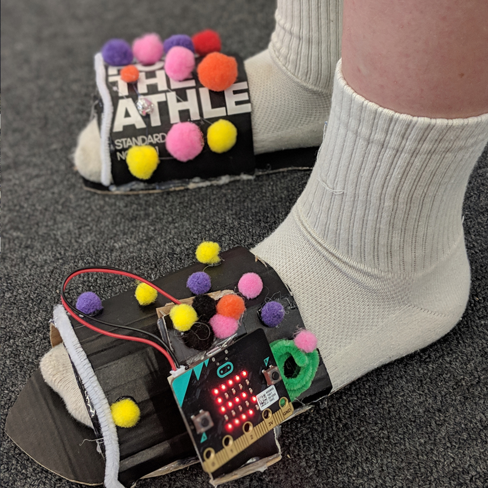 Microbit activity using light sensors and pom poms on shoes