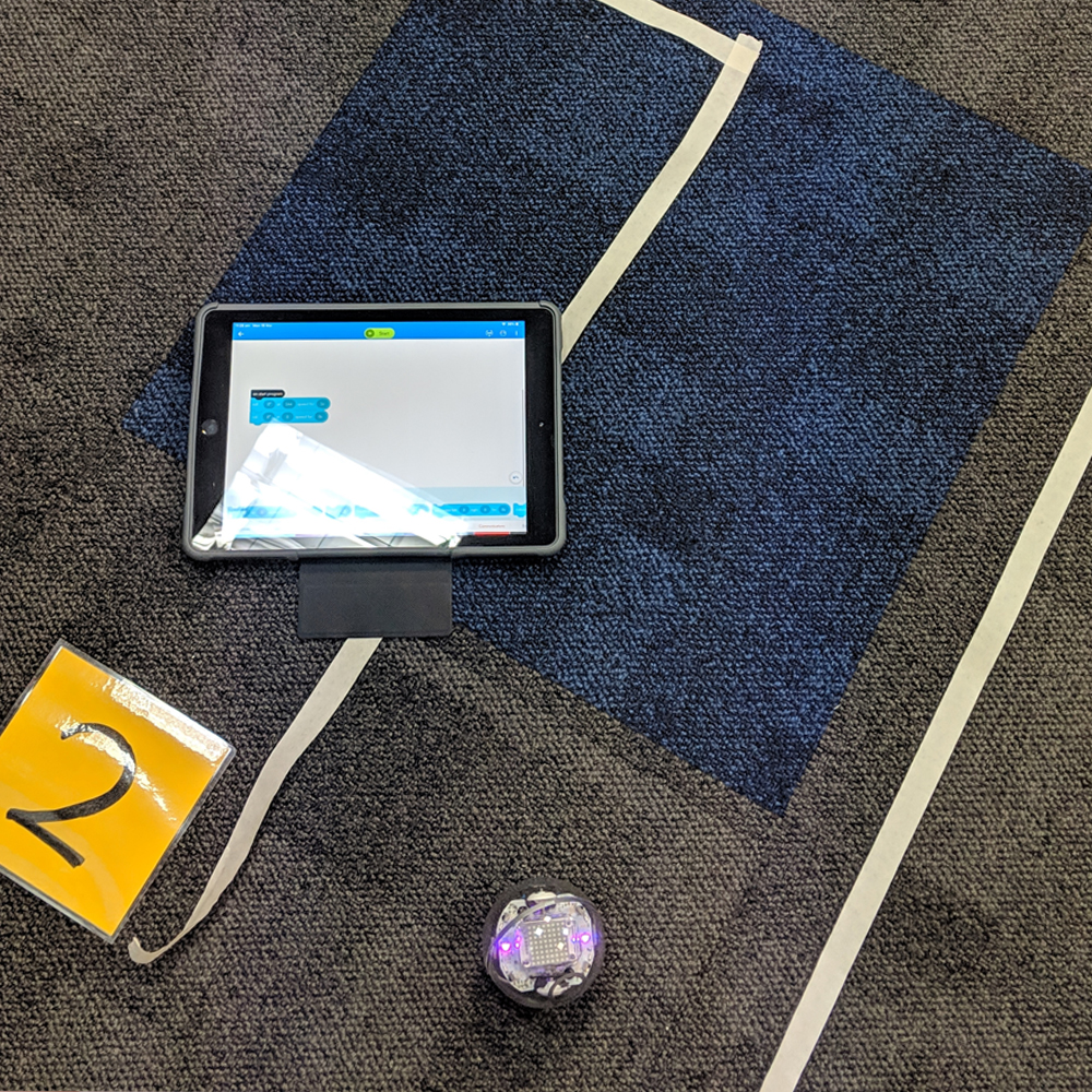 Sphero iPad activity on floor with a route made from tape