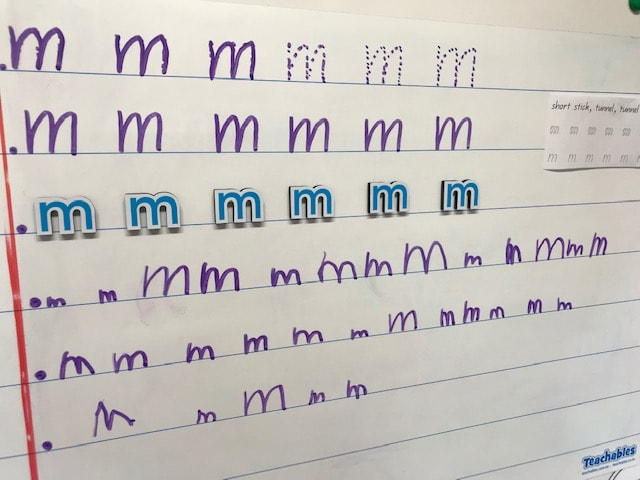 Whiteboard letter formation using the letter M