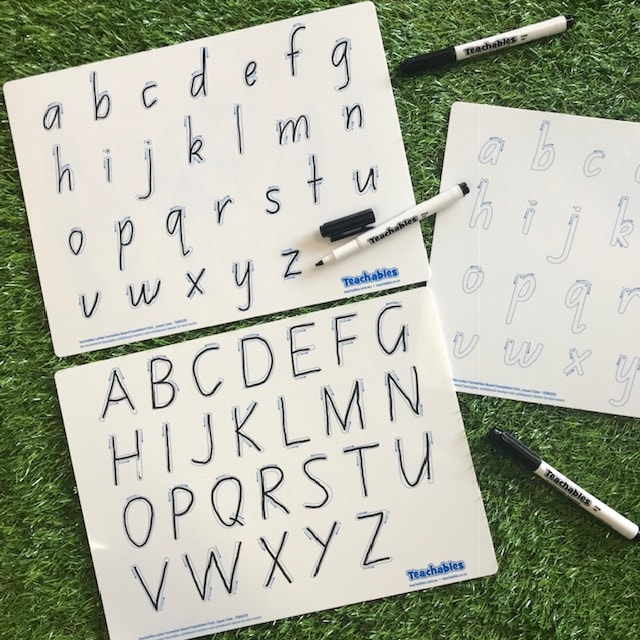 alphabet whiteboards completed on grass background