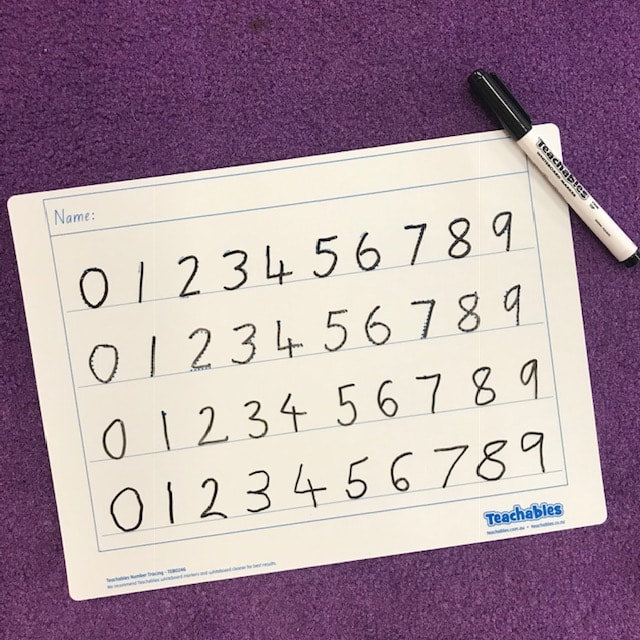 number whiteboard and pen on purple background