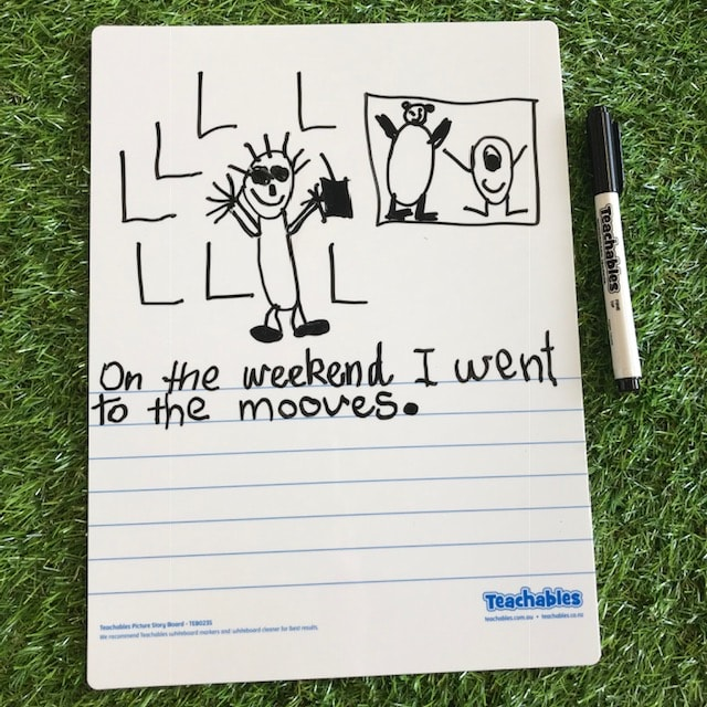 completed picture story whiteboard with pen on grass background