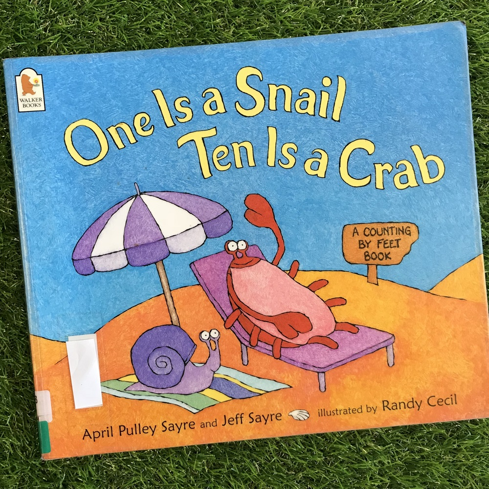 One is a Snail Ten is a Crab book on grass