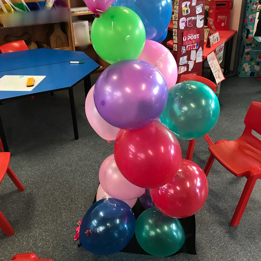 Balloons stacked in a tower