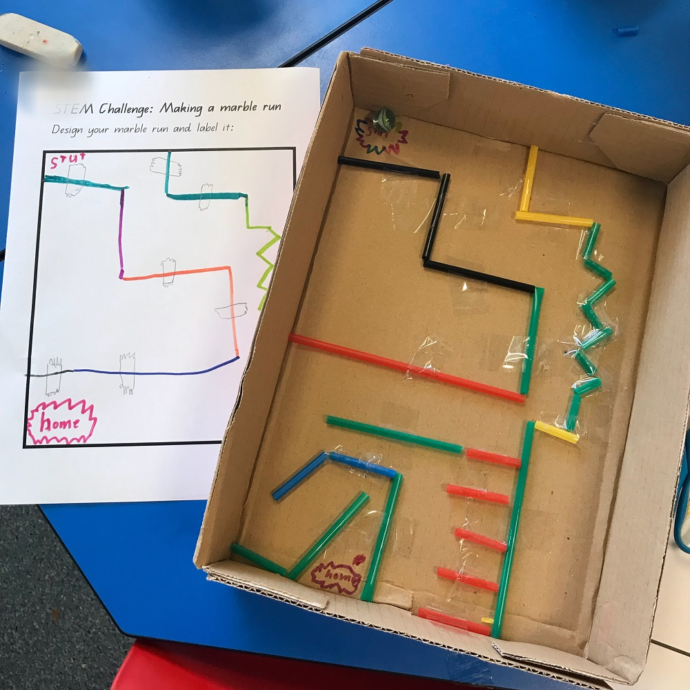 Marble maze built using cardboard box and straws