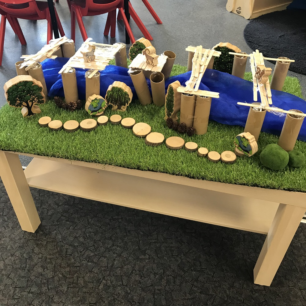 recreation of the story three billy goats gruff made from toilet roll, wooden sticks and false grass