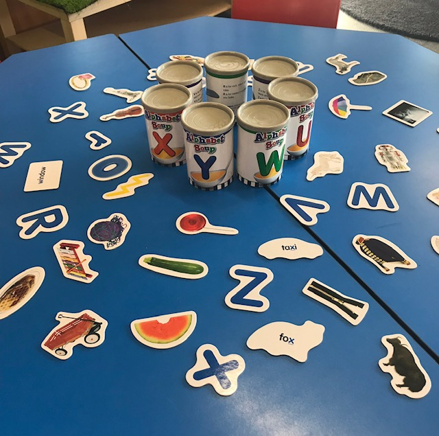 Alphabet soup sorter cans activity on classroom desk