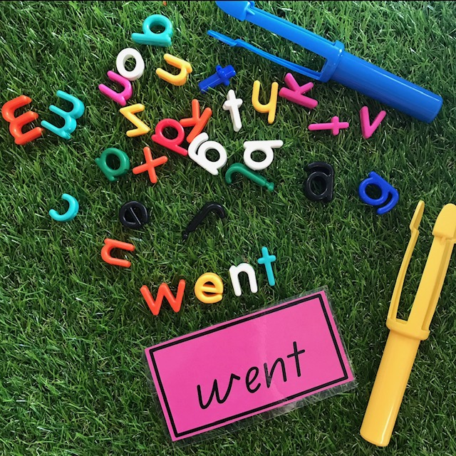 Lowercase letter beads sight word activity on grass background