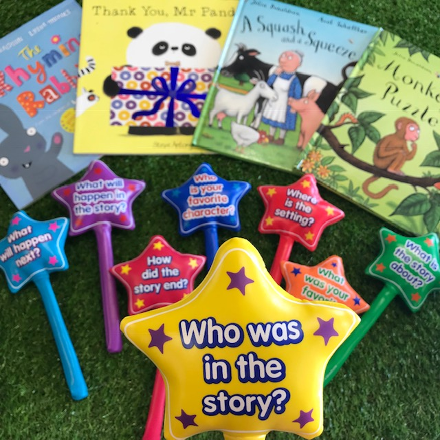 Close up of a Storywand with a series of fiction books on grass background