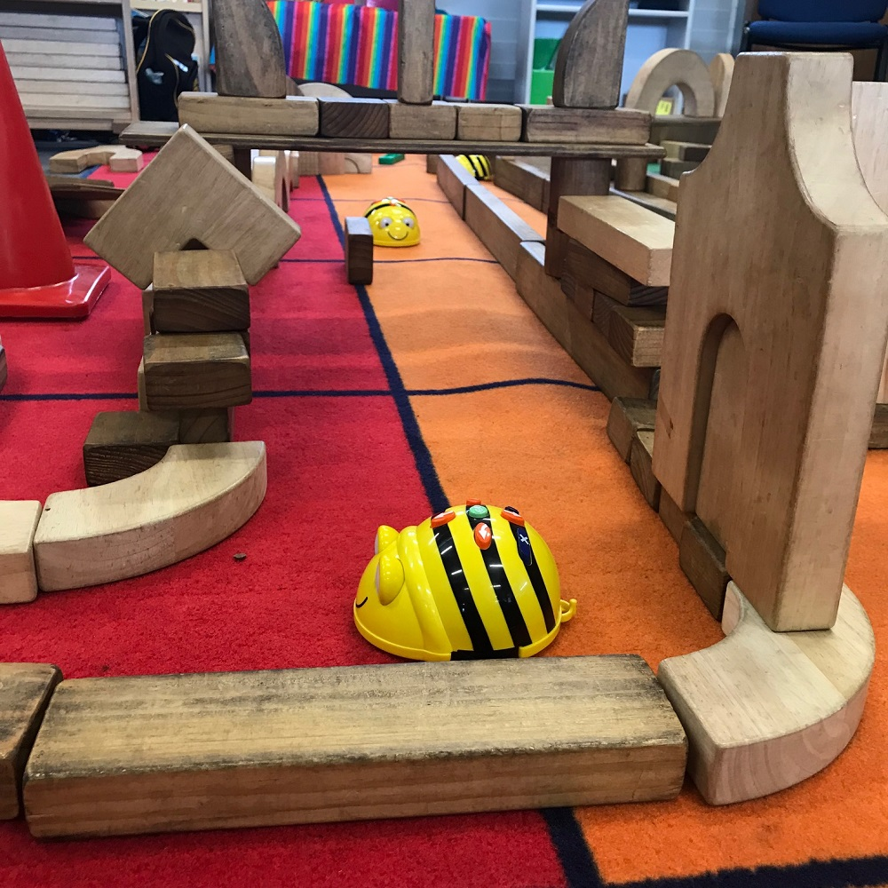 Close up shot of Beebot actively navigating through the wooden block maze