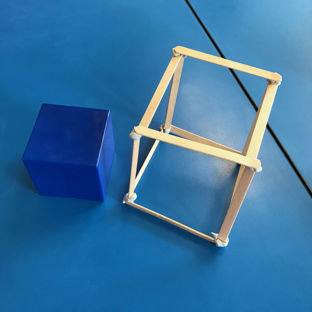 Cube prism shape made of paddle pop sticks stuck together with blu tack
