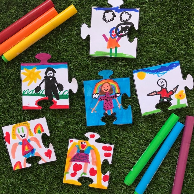 Puzzle artwork with coloured pens on grass