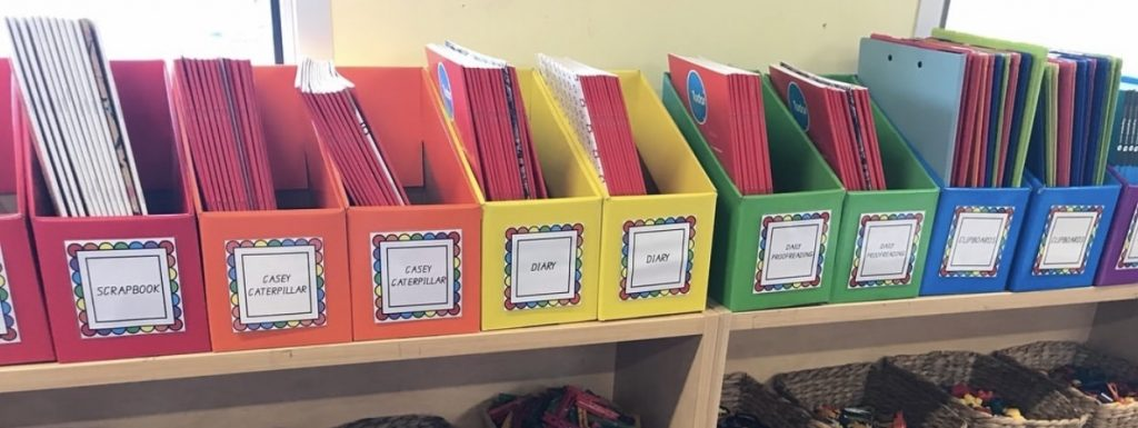 colourful book boxes on shelf