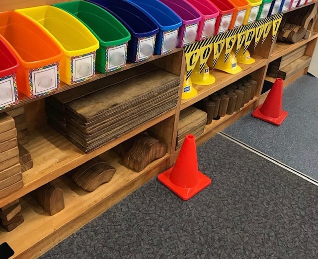 colourful book containers in a classroom setting