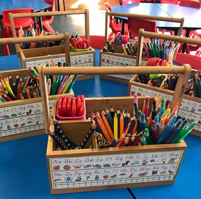 storage caddies filled with classroom reasources in classroom environment