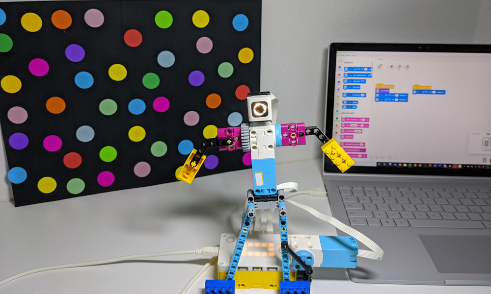 LEGO Education Spike Prime dancing robot and laptop in background