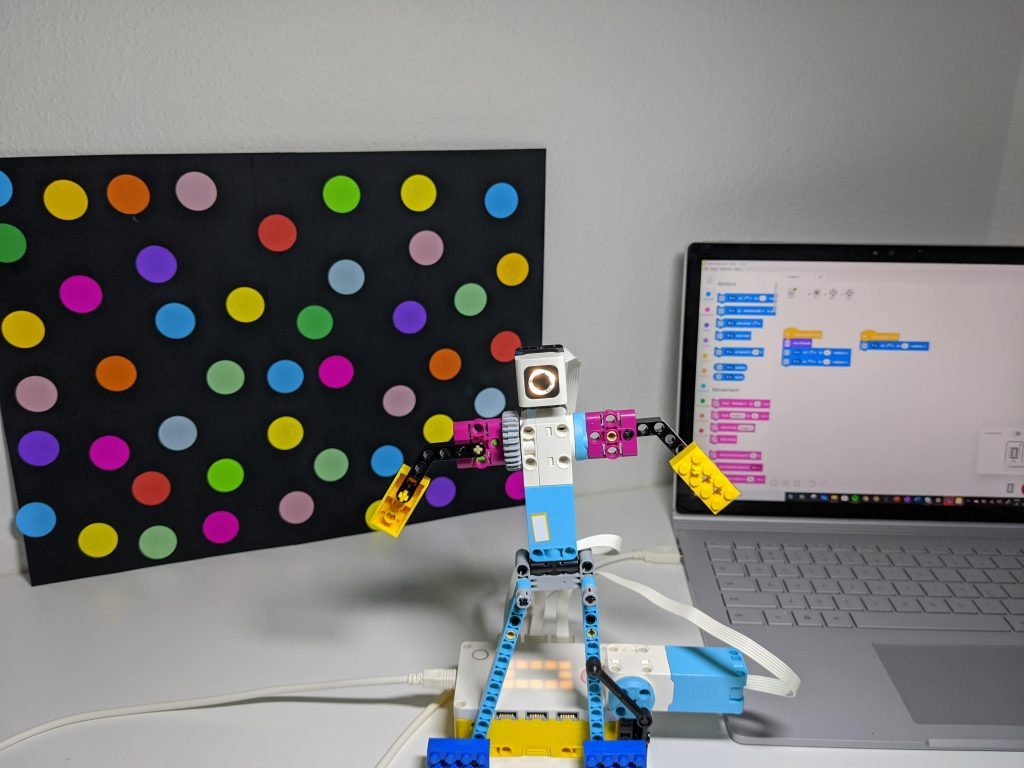 LEGO Spike Dancing Robot with laptop showing Coding blocks in background