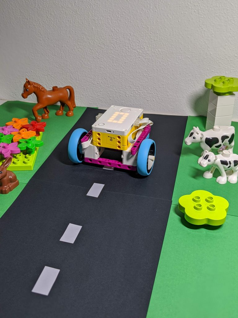 LEGO Spike Futuristic Car on homemade roadside featuring LEGO Duplo trees and animals
