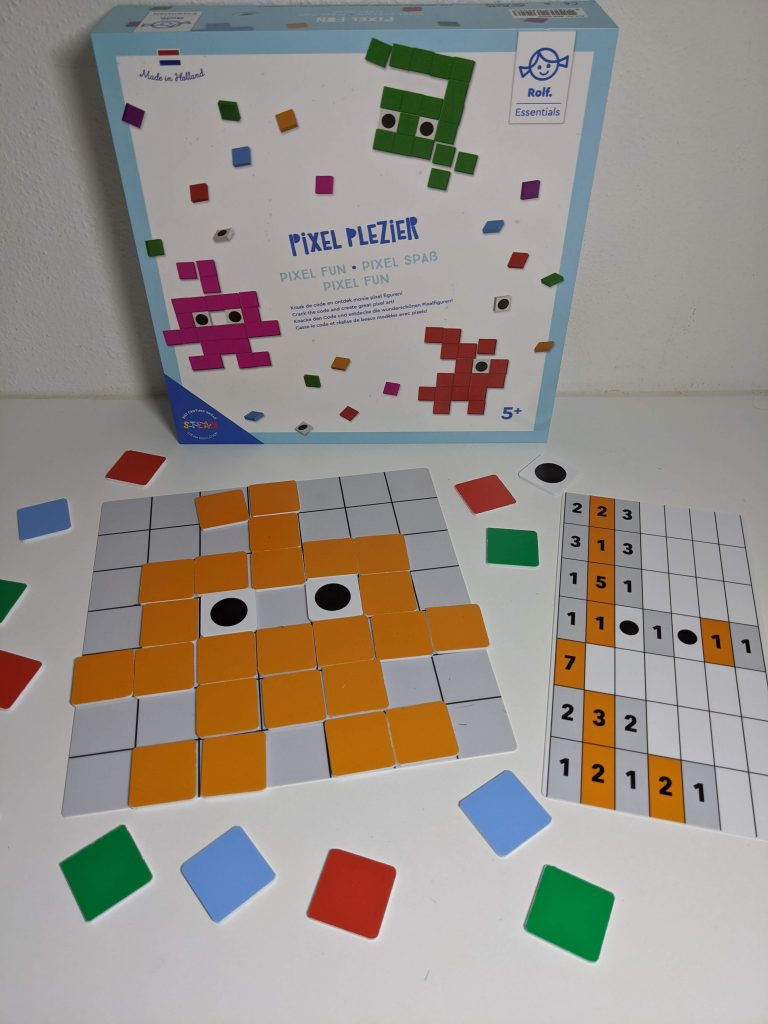 Pixel Plezier game box on table