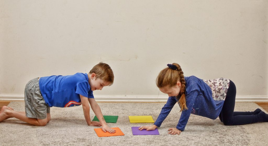 Staying Active at Home_ girl and boy crossing midline on floor