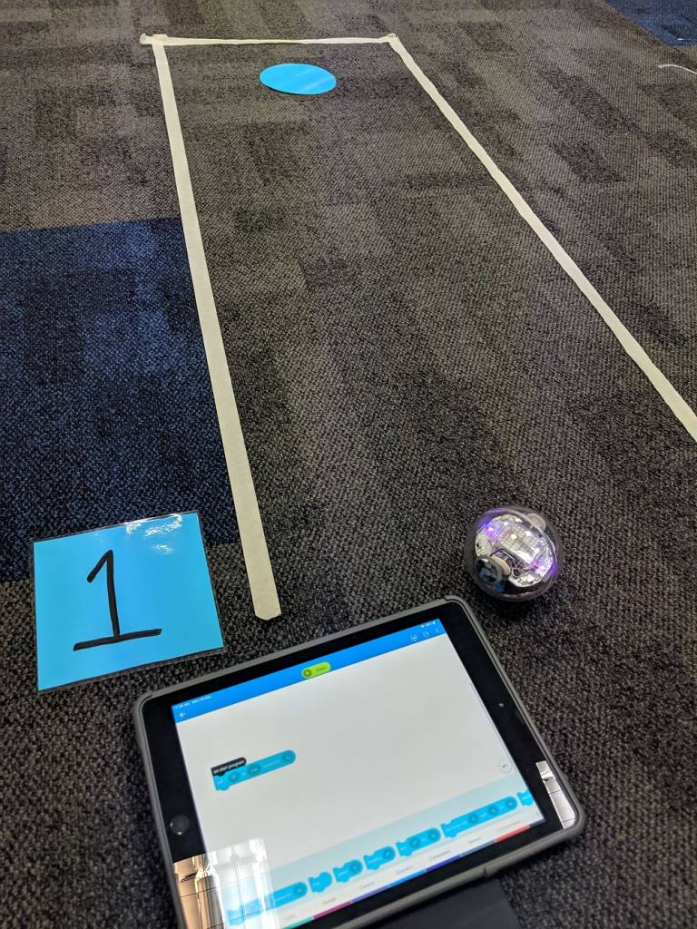 Sphero golf hole with tablet and number 1