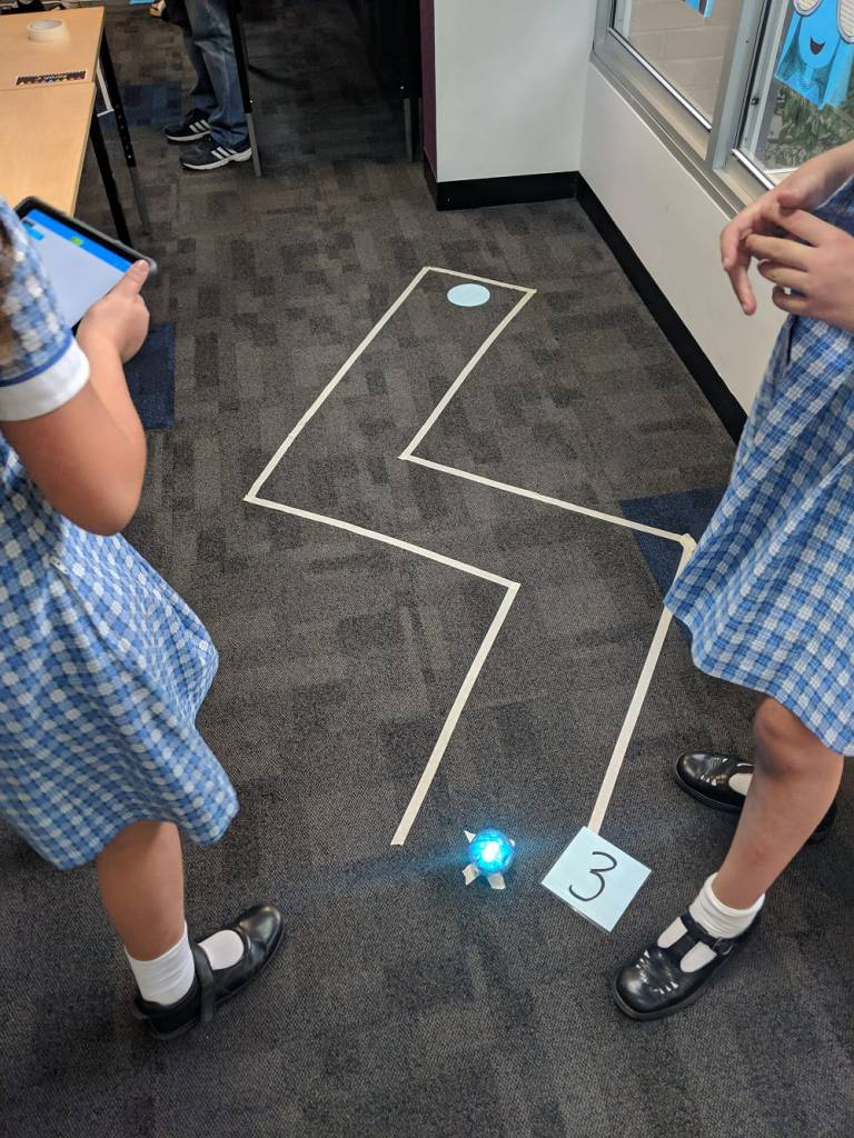 Sphero golf hole with 2 students and number 3
