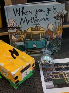Sphero Integrated learning Activity. When you go to Melbourne book. Paper mache bus & Sphero Robot on table