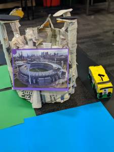 Sphero Integrated learning activity. Structure & bus made from newspapers. Picture of stadium