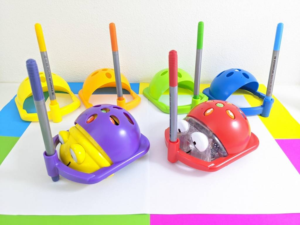 Pen Holder helmets on Beebot and Bluebot sitting on white paper