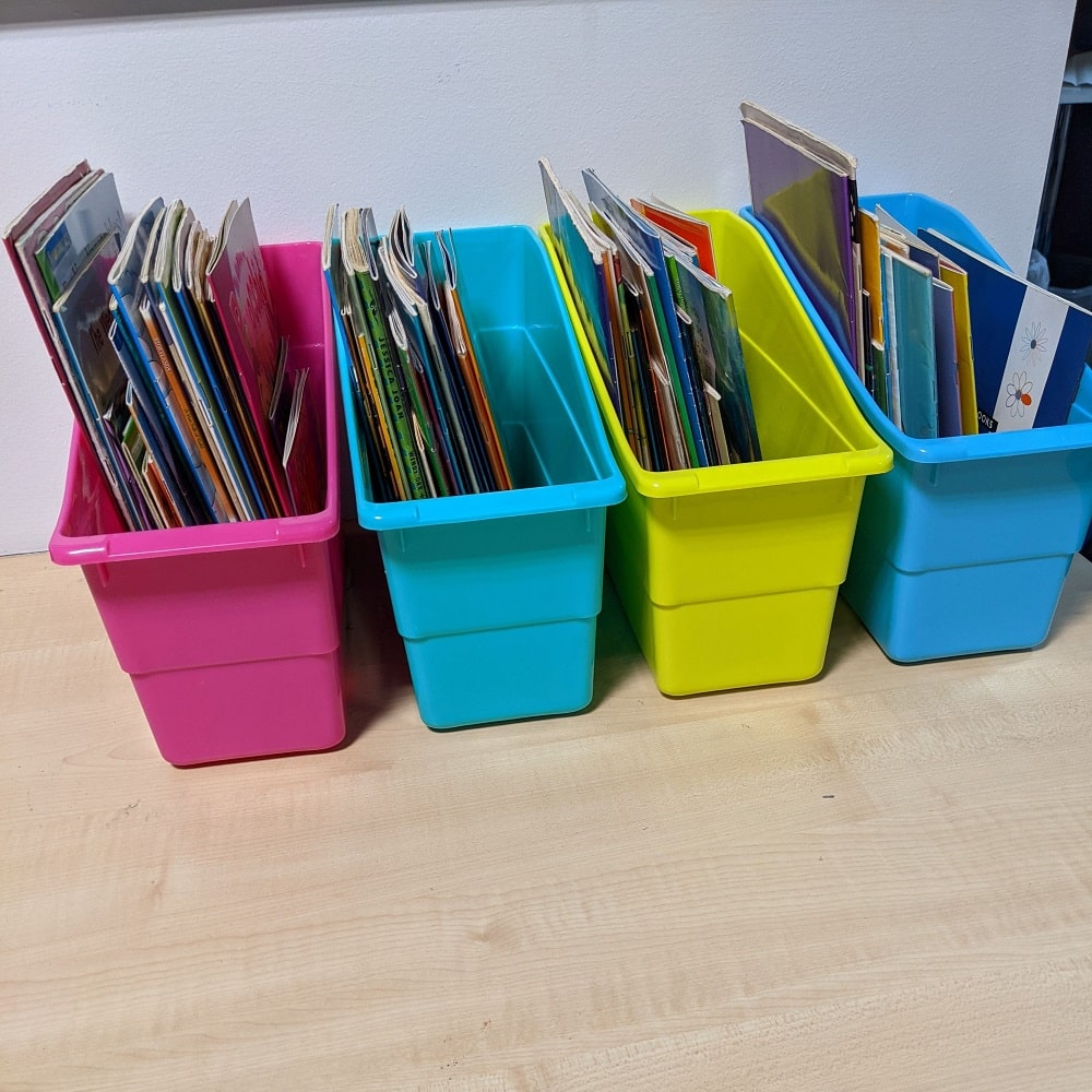 Book caddies filled with books on desk