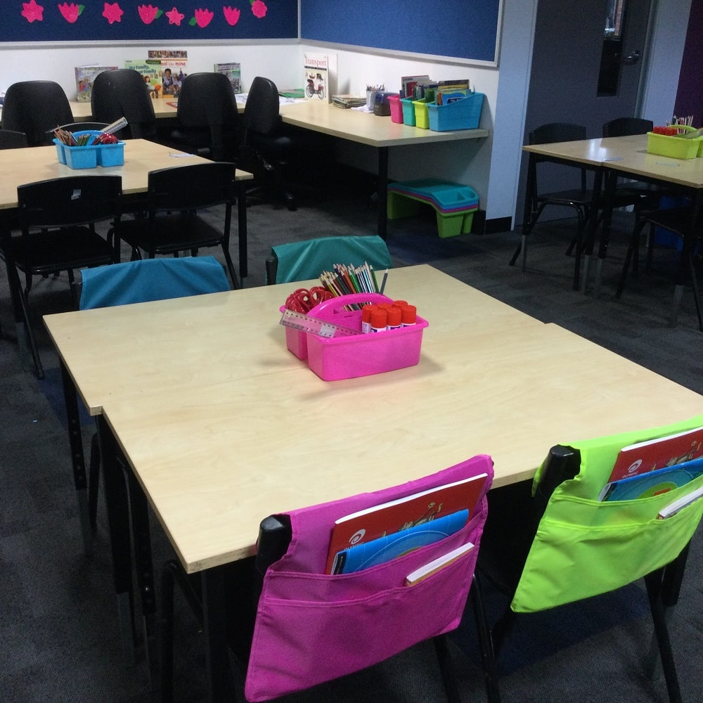 Filled Chairbags and Classroom Caddies on Desk in classroom